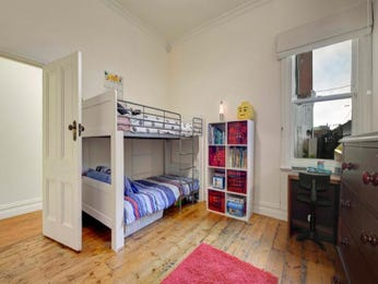Children's room bedroom design idea with floorboards & sash windows using white colours - Bedroom photo 525069