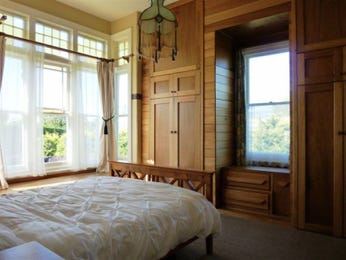 Country bedroom design idea with carpet & built-in wardrobe using cream colours - Bedroom photo 523253