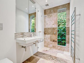 Modern bathroom design with floor-to-ceiling windows using stone - Bathroom Photo 526353