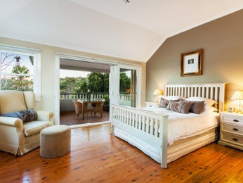 Country bedroom design idea with floorboards & balcony using beige colours - Bedroom photo 525545
