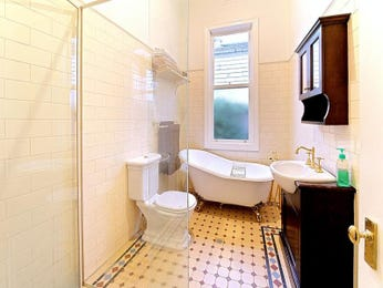 French provincial bathroom design with claw foot bath using tiles - Bathroom Photo 524797