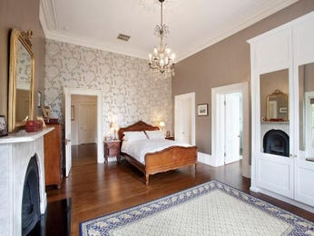 Period bedroom design idea with floorboards & fireplace using neutral colours - Bedroom photo 1603269