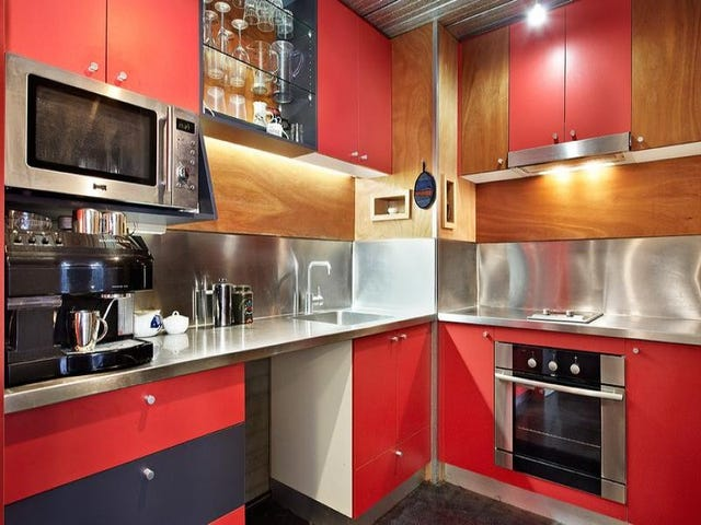 Not normally a fan of colours but this does work! Great choice of red against the wood and the stainless steel adds masses of reflective light.