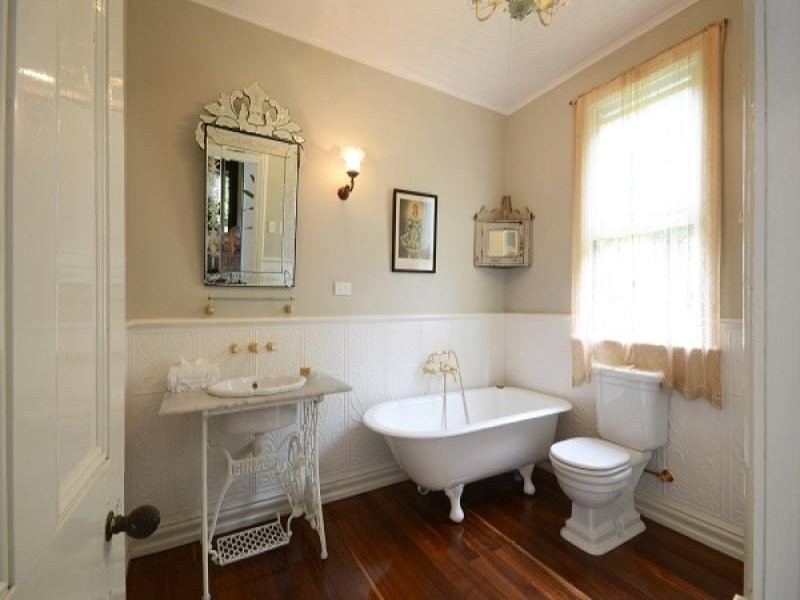 French provincial bathroom design with claw foot bath for French bathroom decor