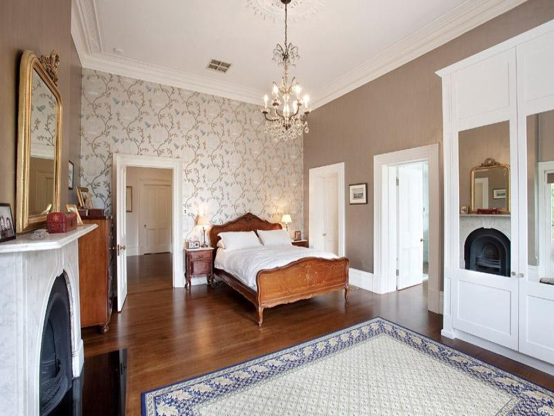 Period bedroom design idea with floorboards fireplace for Bedroom designs and colours