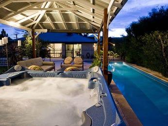 endless pool design using stone with gazebo hedging pool photo 359407
