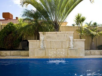 Tropical pool design using stone with pool fence & sculpture - Pool photo 1482951