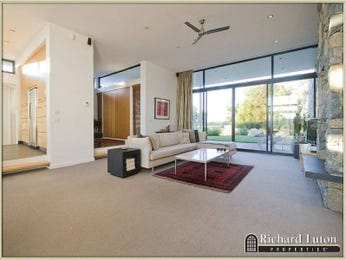 Split-level living room using grey colours with carpet & fireplace - Living Area photo 388066