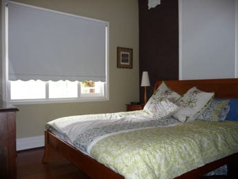 Brown bedroom design idea from a real Australian home - Bedroom photo 365109