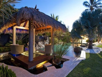 In-ground pool design using grass with cabana & decorative lighting - Pool photo 122947