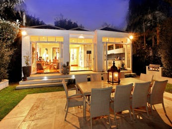 Indoor-outdoor outdoor living design with bbq area & decorative lighting using grass - Outdoor Living Photo 444808