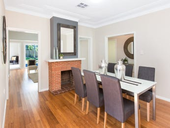 Classic dining room idea with floorboards & fireplace - Dining Room Photo 15109417