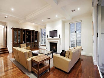 Split-level living room using brown colours with laminate & fireplace - Living Area photo 363152