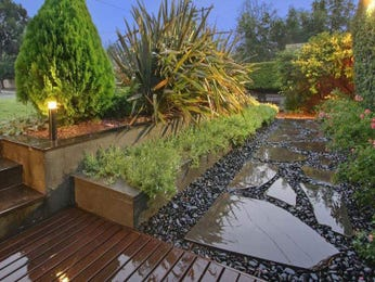 Landscaped garden design using pavers with deck & ground lighting - Gardens photo 126707