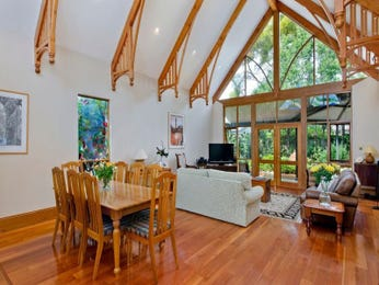 Casual dining room idea with floorboards & exposed eaves - Dining Room Photo 7552145