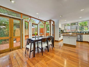 Classic dining room idea with floorboards & floor-to-ceiling windows - Dining Room Photo 8262201