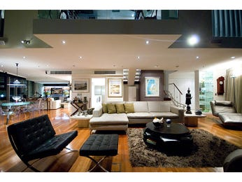 Open plan living room using black colours with floorboards & floor-to-ceiling windows - Living Area photo 127010