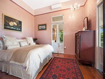 Classic bedroom design idea with floorboards & balcony using pink colours - Bedroom photo 127700
