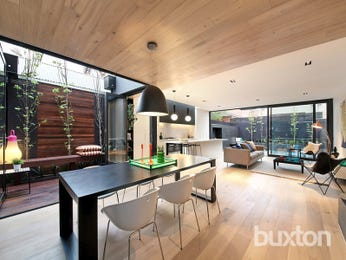 Modern dining room idea with floorboards & floor-to-ceiling windows - Dining Room Photo 16825317