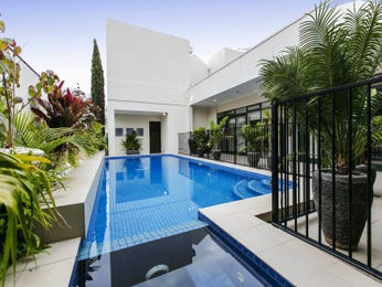 Tropical pool design using wrought iron with retaining wall & sculpture - Pool photo 15817097