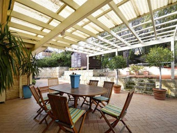 Indoor-outdoor outdoor living design with bbq area & latticework fence using brick - Outdoor Living Photo 134217