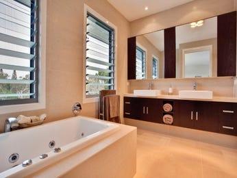Classic bathroom design with louvre windows using ceramic ...