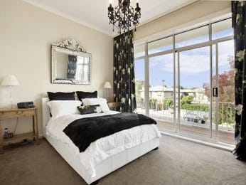 Classic bedroom design idea with leather & floor-to-ceiling windows using white colours - Bedroom photo 494067