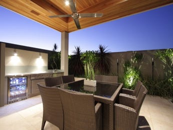 Indoor-outdoor outdoor living design with bbq area & decorative lighting using grass - Outdoor Living Photo 182395