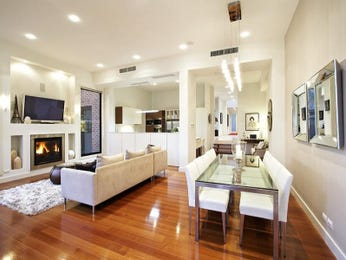Dining-living living room using white colours with floorboards & fireplace - Living Area photo 1013258