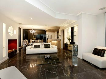 Open plan living room using brown colours with tiles & fireplace - Living Area photo 7232937