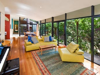 Open plan living room using yellow colours with floorboards & floor-to-ceiling windows - Living Area photo 7386781