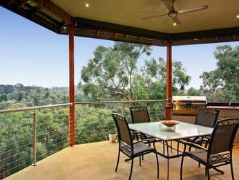 Indoor-outdoor outdoor living design with balcony & decorative lighting using grass - Outdoor Living Photo 184898