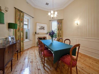 Classic dining room idea with floorboards & fireplace - Dining Room Photo 185061