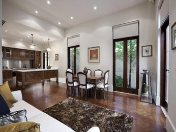Dining-living living room using brown colours with floorboards & bay windows - Living Area photo 185420