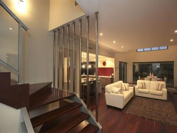 Open plan living room using brown colours with floorboards & sash windows - Living Area photo 465373