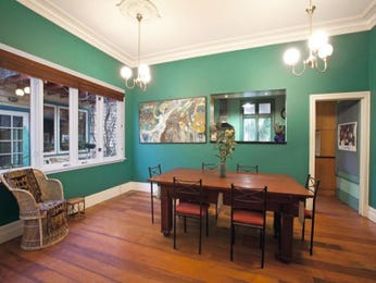 Casual dining room idea with floorboards & bay windows - Dining Room Photo 187906