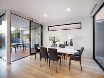 Retro dining room idea with floorboards & floor-to-ceiling windows - Dining Room Photo 7293929