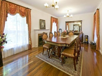 Classic dining room idea with hardwood & fireplace - Dining Room Photo 189637