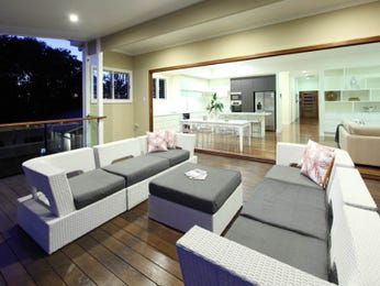 Split-level living room using cream colours with hardwood & bay windows - Living Area photo 190118