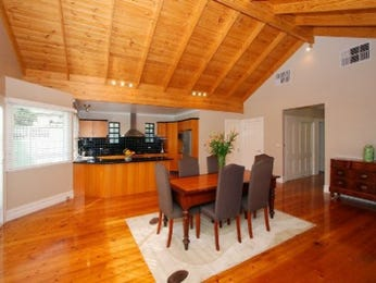 Casual dining room idea with floorboards & exposed eaves - Dining Room Photo 440293
