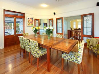 Modern dining room idea with floorboards & french doors - Dining Room Photo 191457