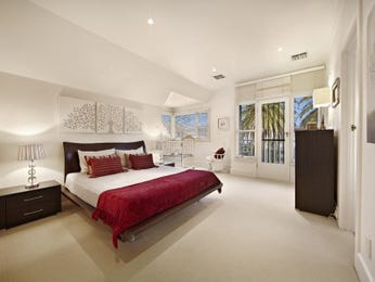 Asian-inspired bedroom design idea with carpet & french doors using red colours - Bedroom photo 192385
