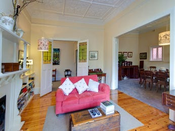 Dining-living living room using brown colours with carpet & fireplace - Living Area photo 473720