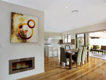 Modern dining room idea with floorboards & fireplace - Dining Room Photo 14947589