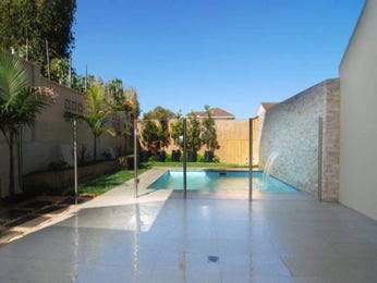 Freeform pool design using brick with decking & ground lighting - Pool photo 194507