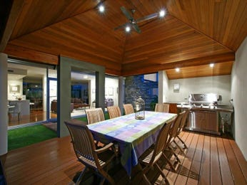 Indoor-outdoor outdoor living design with bbq area & decorative lighting using grass - Outdoor Living Photo 195891