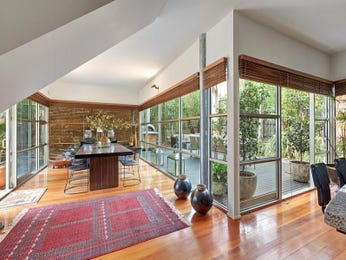 Modern dining room idea with exposed brick & floor-to-ceiling windows - Dining Room Photo 7516493