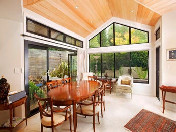 Classic dining room idea with hardwood & floor-to-ceiling windows - Dining Room Photo 7266085