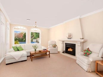 Open plan living room using beige colours with carpet & bay windows - Living Area photo 248055