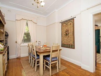 Classic dining room idea with hardwood & sash windows - Dining Room Photo 418492